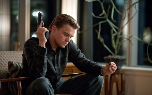 start-inception-leonardo-dicaprio-cobb-sits-the-gun-looks-whirligig